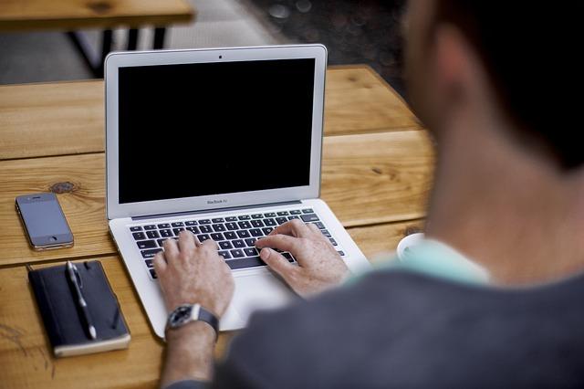 Man at laptop. Join FCB